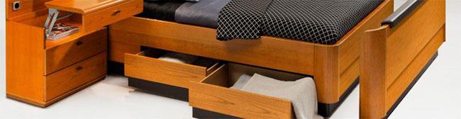 Секции для хранения вещей в кровати